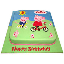 Peppa Pig on a cycle Cake: Designer Cakes
